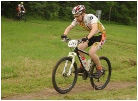 Larry racing his mountain bike.